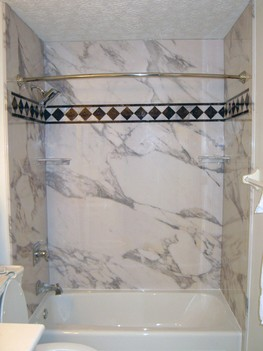 Acrylic Bathtub with Calcutta Gold Wall Surrounds